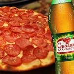 Compre uma pizza grande (8 pedaços) e ganhe  1 refrigerante 2 litros